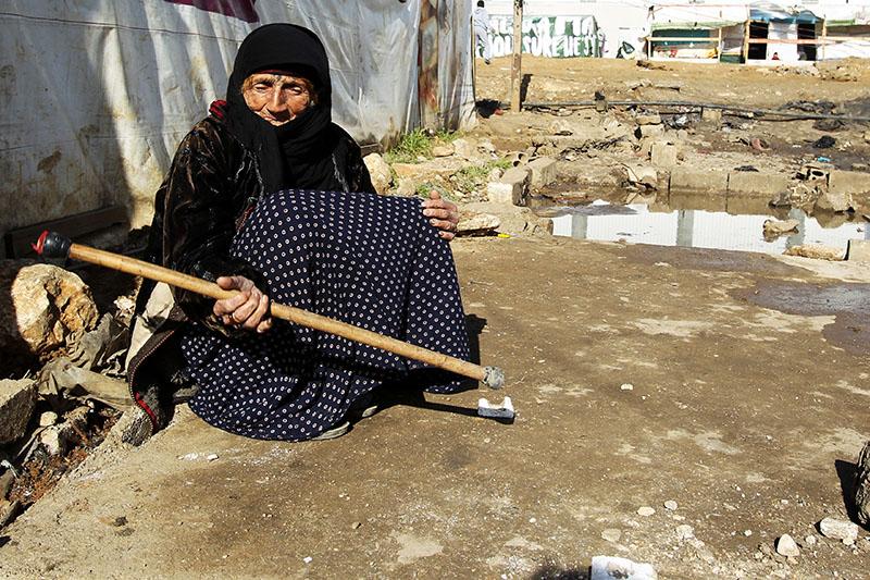 Жительница Сирии в лагере для беженцев