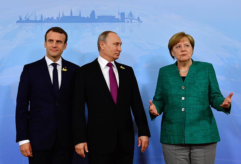 Владимир Путин, канцлер Германии Ангела Меркель и президент Франции Эммануэль Макрон
