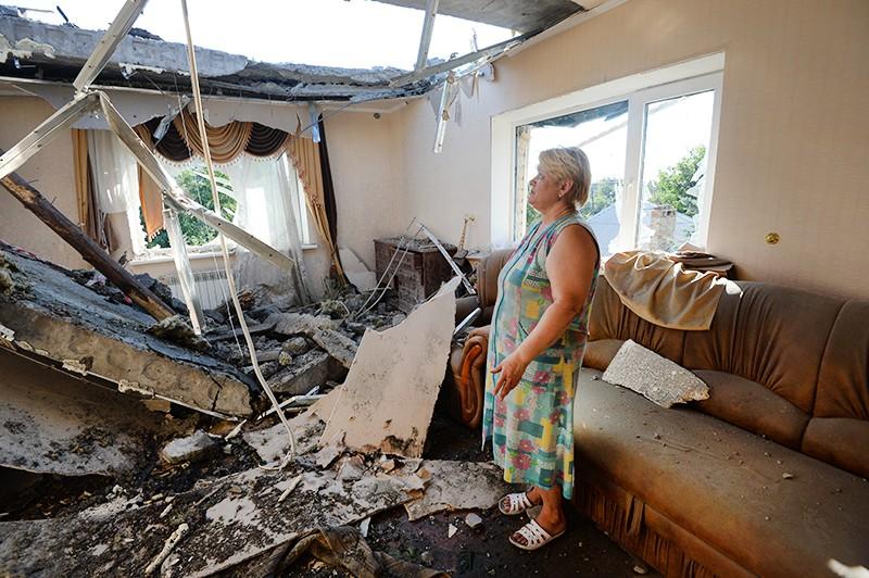 Последствия обстрелов жилых районов Донбасса