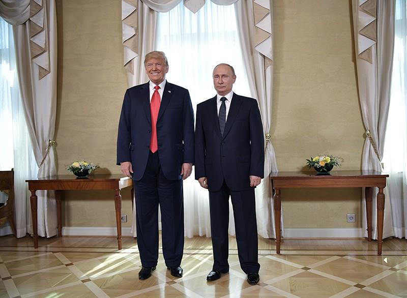 Владимир Путин и президент США Дональд Трамп