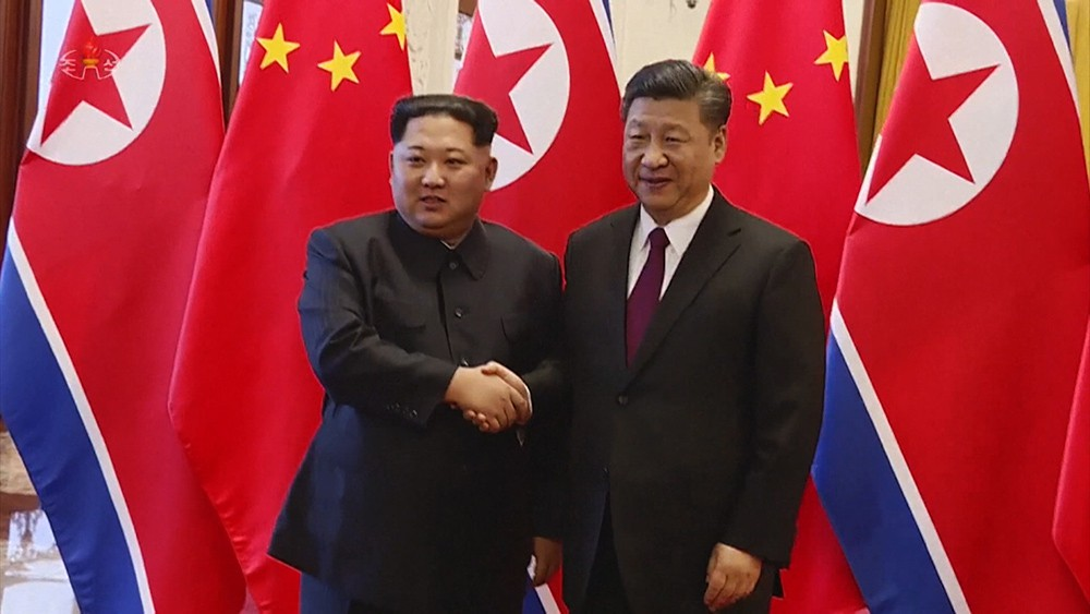 Си Цзиньпин и Ким Чен Ын во время встречи