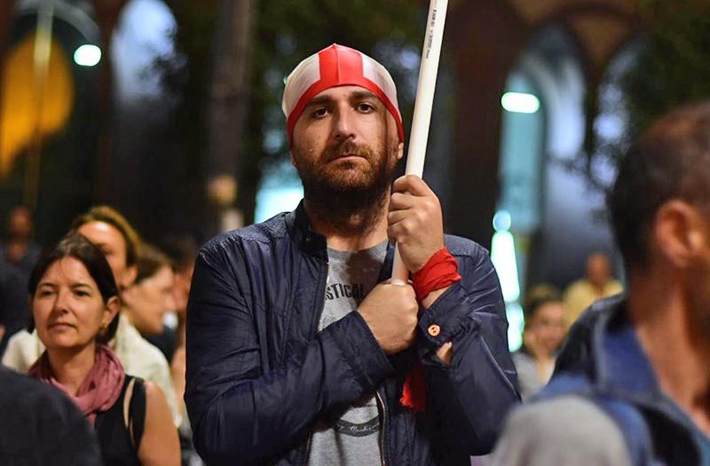 Участник митинга в Тбилиси