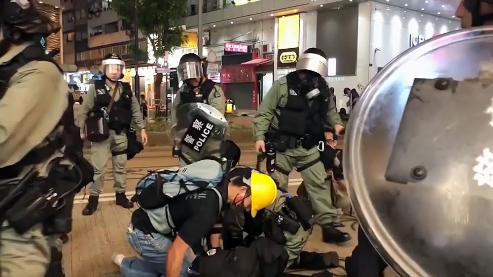 Полиция КНР задерживает протестующих