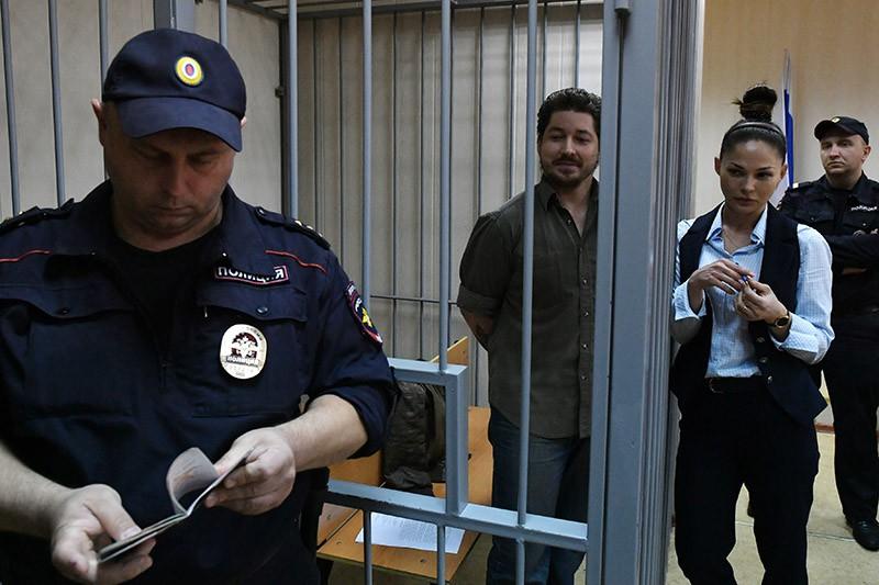 Кирилл Жуков (в центре), обвиняемый по уголовному делу о массовых беспорядках в центре Москвы 27 июля