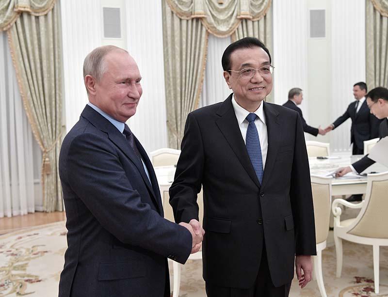 Владимир Путин и премьер Государственного совета КНР Ли Кэцян