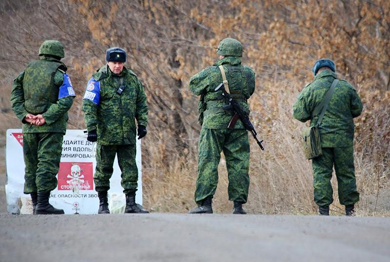 Члены совместного центра контроля и координации прекращения огня в Донецкой области