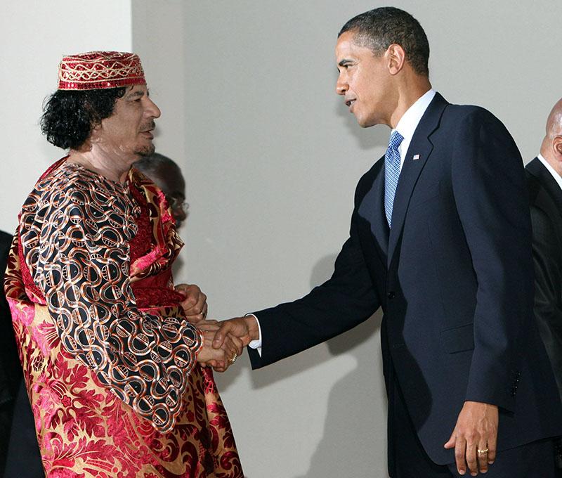 Муаммар Каддафи и Барак Обама