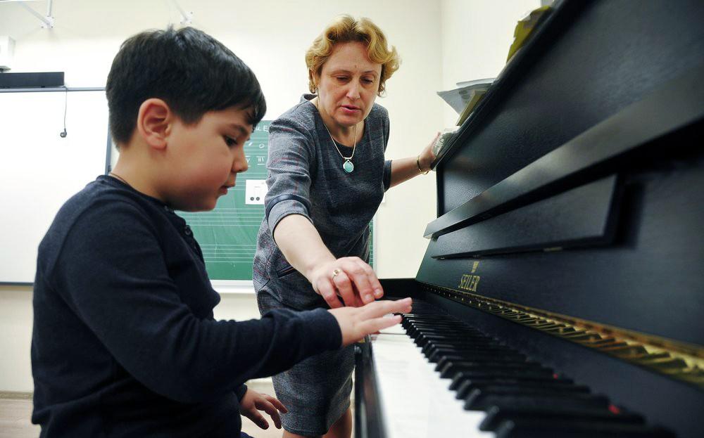 Музыкальный преподаватель
