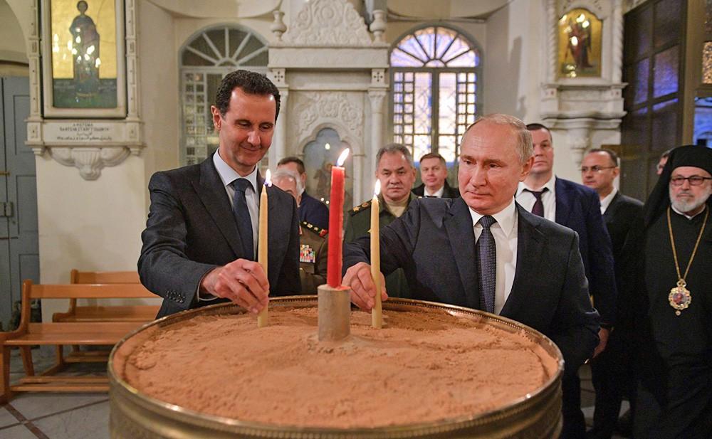 Владимир Путин и Башар Асад в православной церкви Святой Девы Марии в Сирии