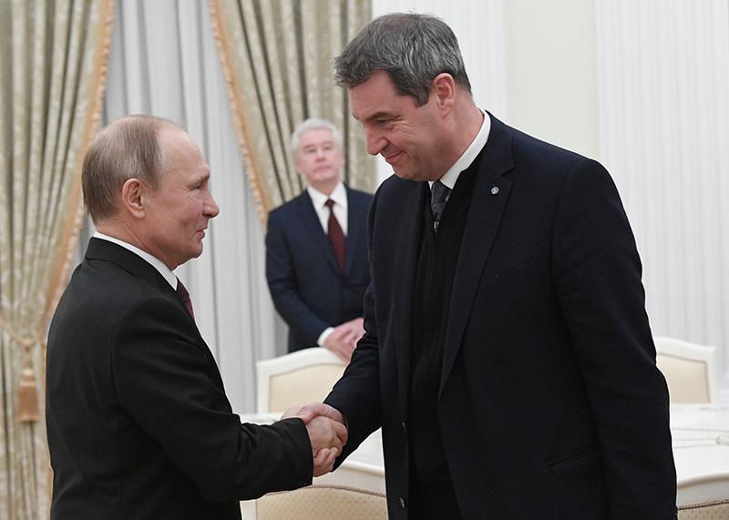 Владимир Путин и премьер-министр федеральной земли Бавария Маркус Зедер