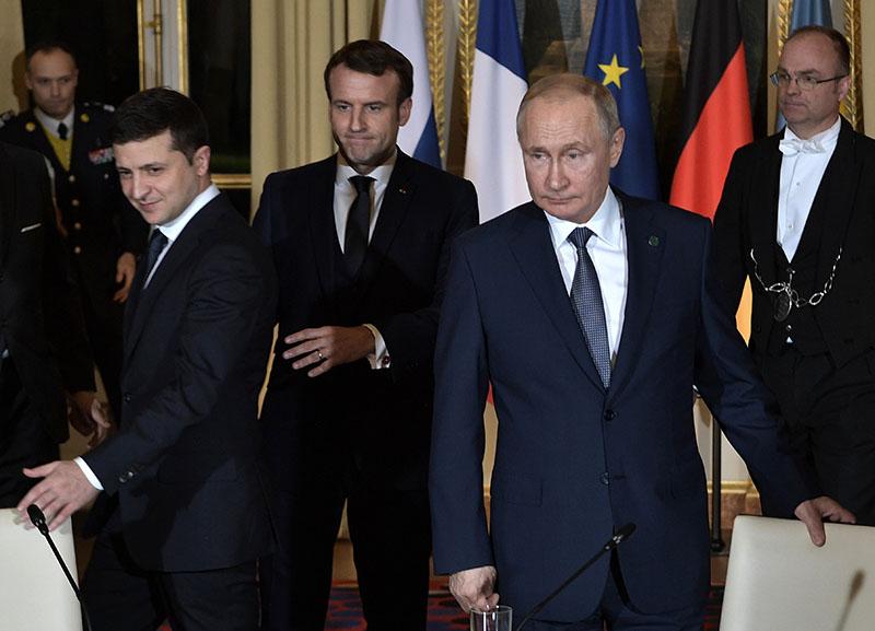 Владимир Путин, президент Франции Эммануэль Макрон и президент Украины Владимир Зеленский