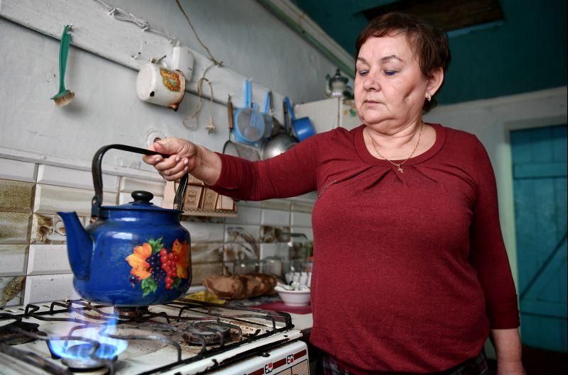 Женщина у плиты