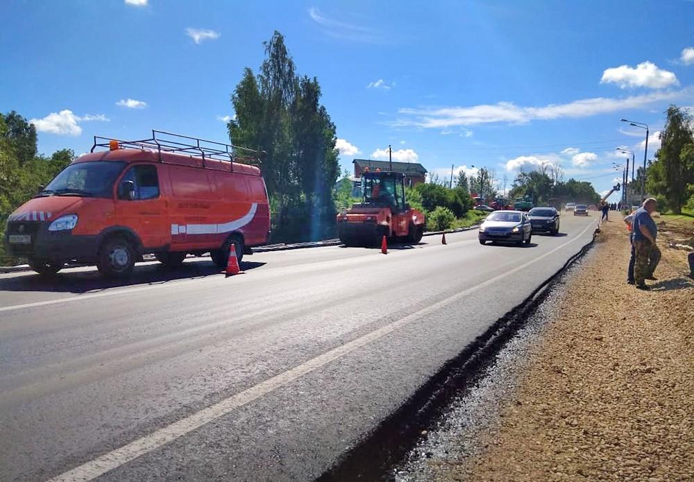 Восстановленная дорога после прорва дамбы в Рузе