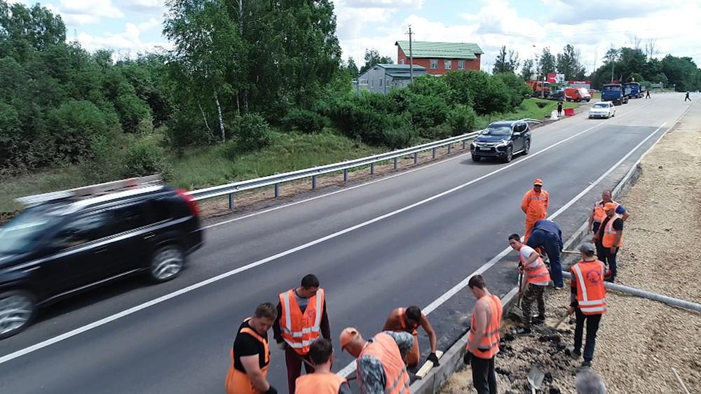 Восстановленная дорога после прорва дамбы в Рузет
