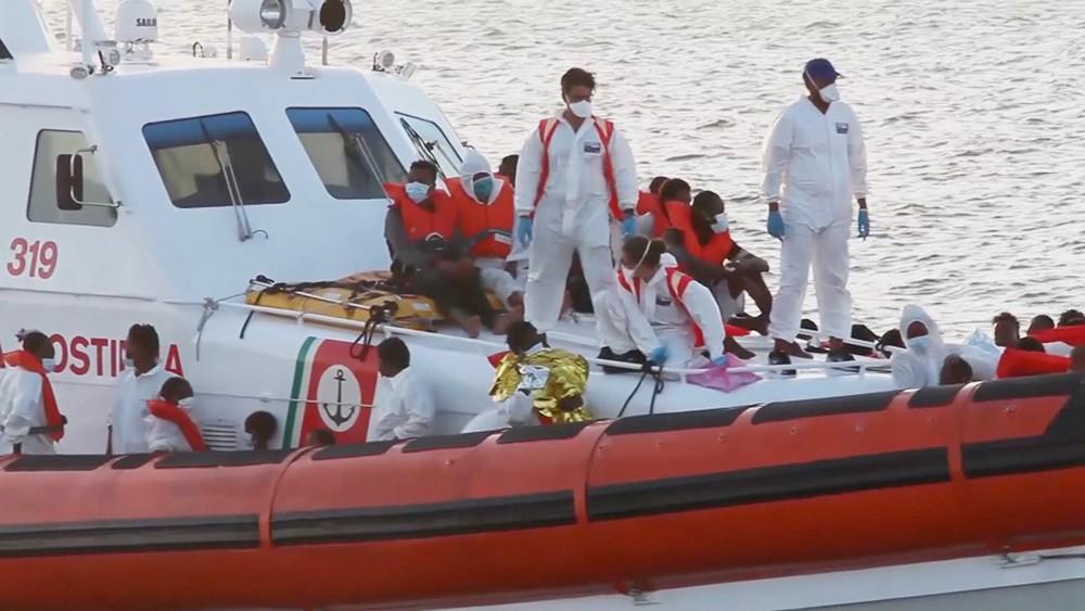 Мигранты в Италии