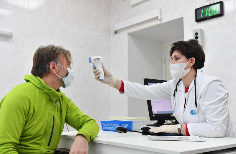 Измерение температуры перед вакцинацией