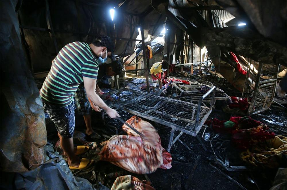 Последствия пожара в госпитале в Ираке