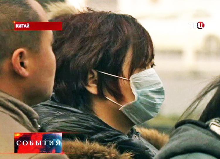 Житель Китая в маске