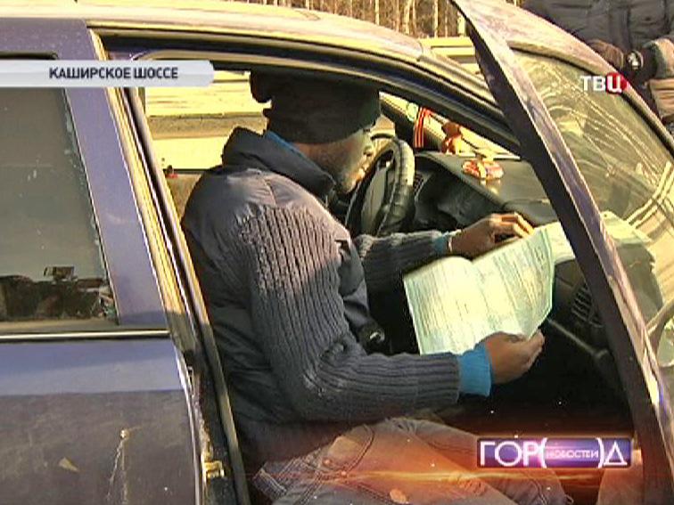 Водитель машины с иностранными номерами